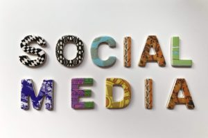 "The words ""social media"" in colorful block letters."