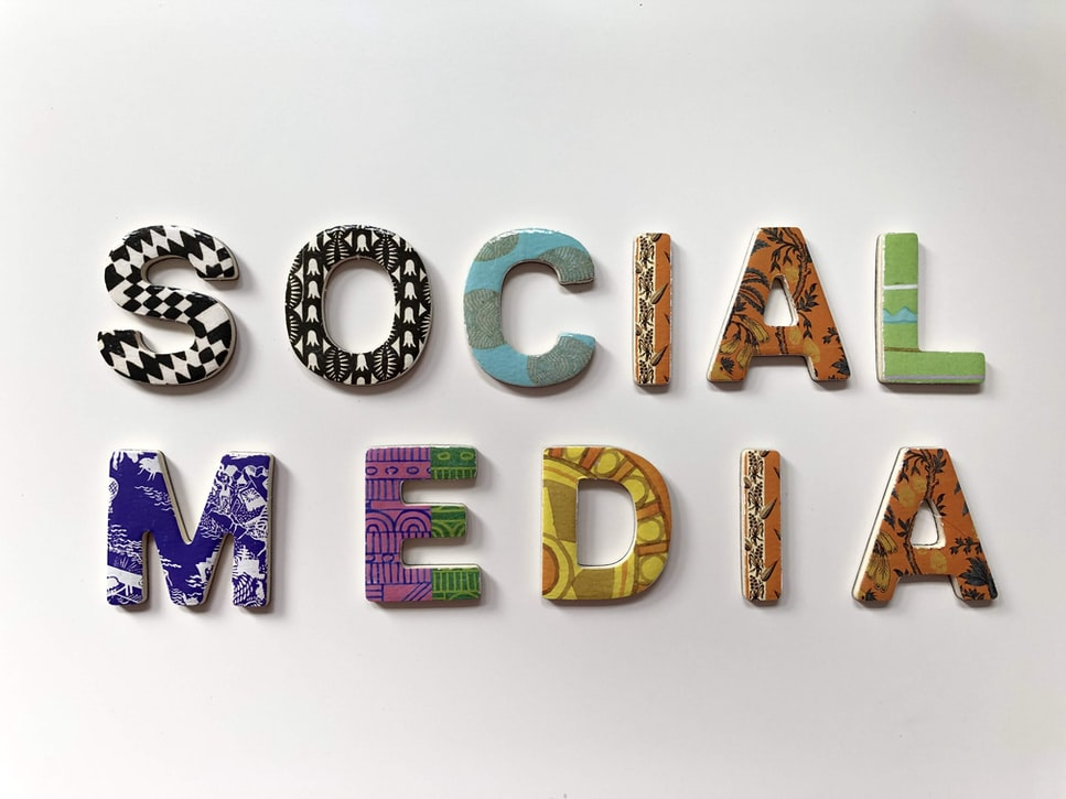 """The words """"social media"""" in colorful block letters."""